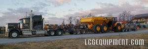 Volvo A60H Rock Truck on lowbed and hauled